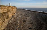 rocky foreshore, southern cliff and 'short' lighthouse at Nash Point